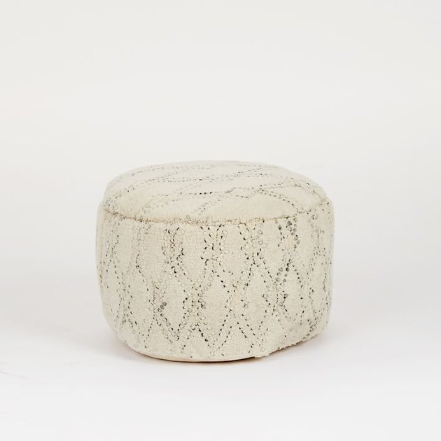 White pouf with subtle black design