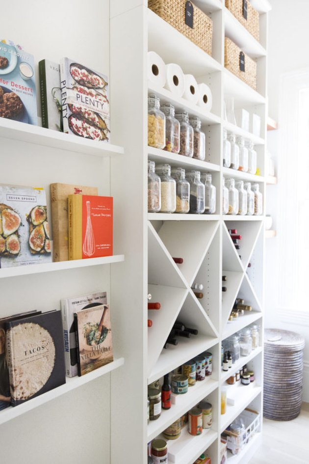 organized pantry with wine rack and cookbooks