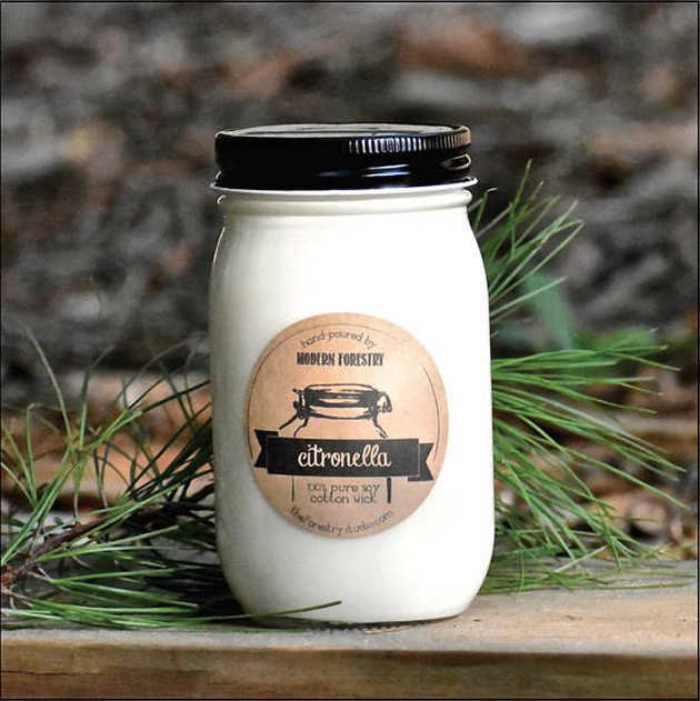 A black-and-cream mason jar with a citronella candle label.