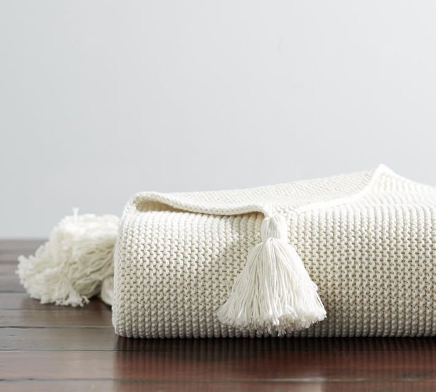 Cream knitted throw blanket with tassels