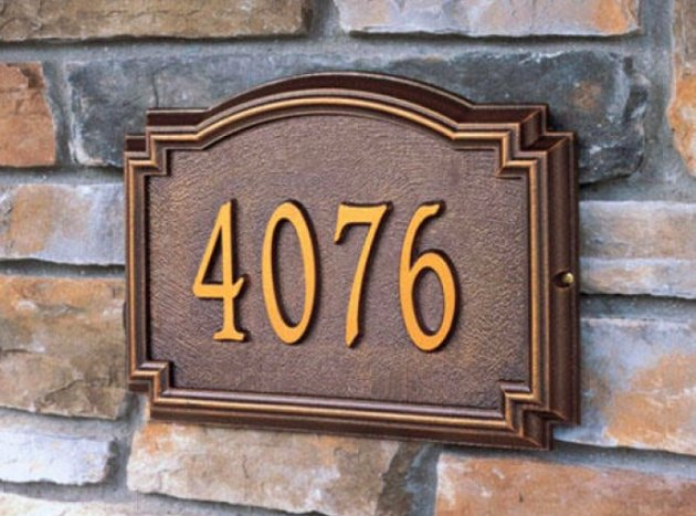 House numbers on brick.