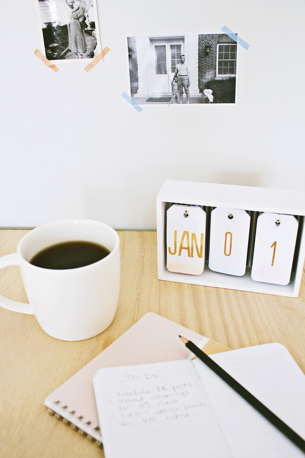 A hanging-tag desk calendar with a subtle ombre.