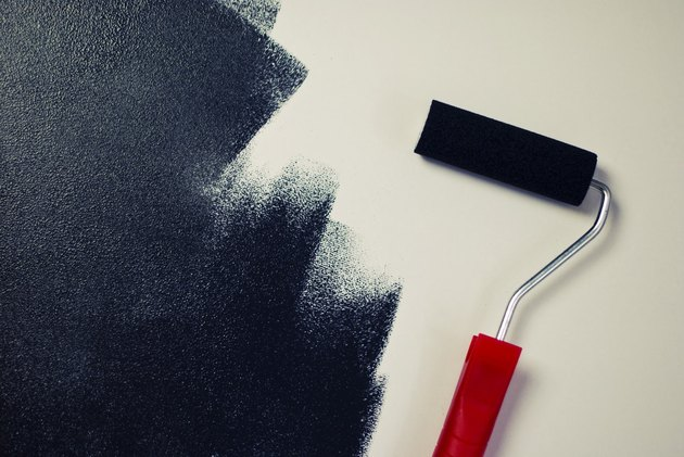 Painting a white wall black.