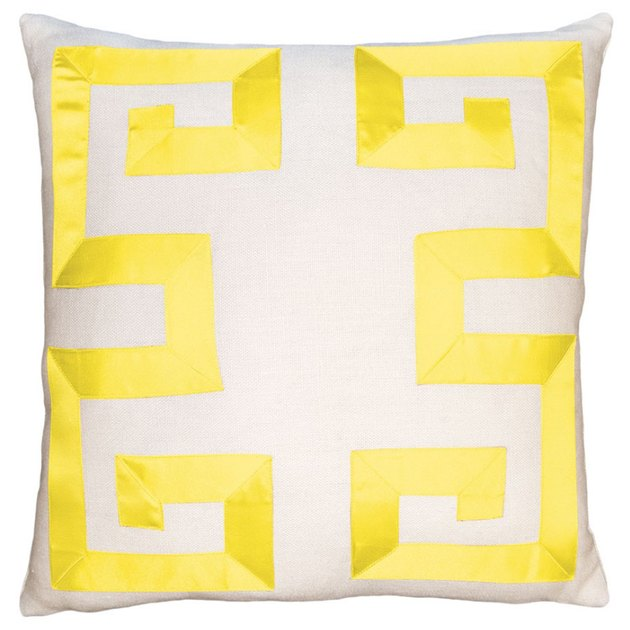 White pillow with bright yellow pattern