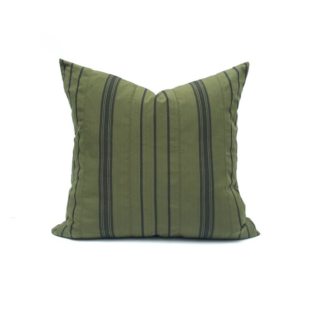 Olive throw pillow with thin black stripes
