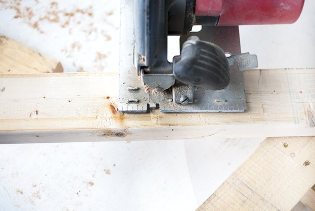 Circular saw cutting 2x4.