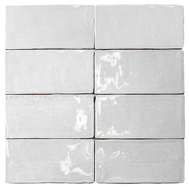 Eight pieces of white subway tile