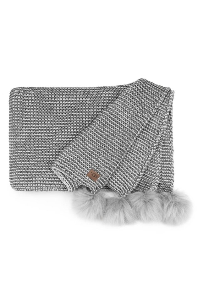 Gray throw blanket with pom-pom fringe