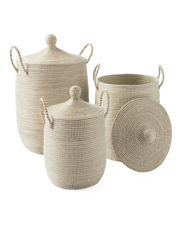 Three light beige woven baskets with lids