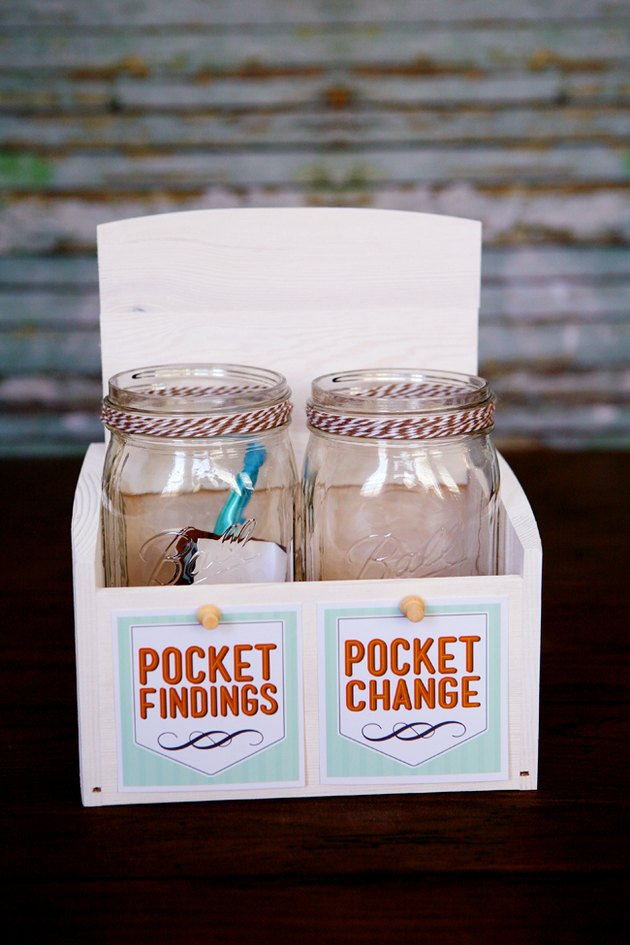 "Two mason jars, one saying ""Pocket Change"" and one saying ""Pocket Findings"""