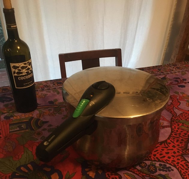 A stovetop pressure cooker on the table.