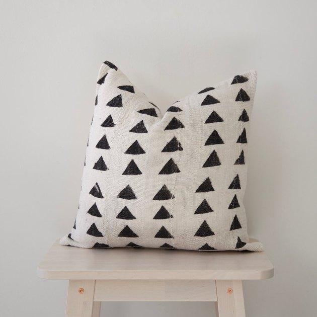 White square throw pillow with black triangles