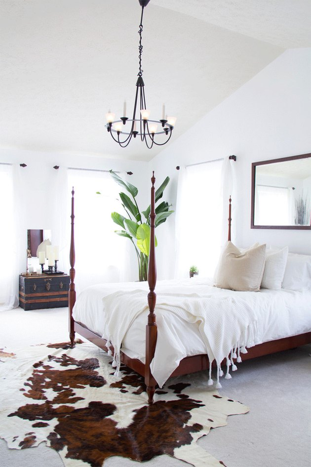 Bedroom featuring cowhide rug