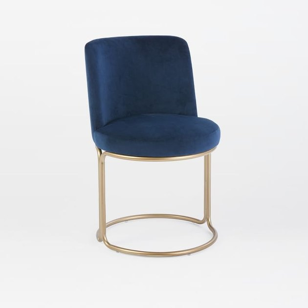 Minimal navy blue dining chair with circular brass base