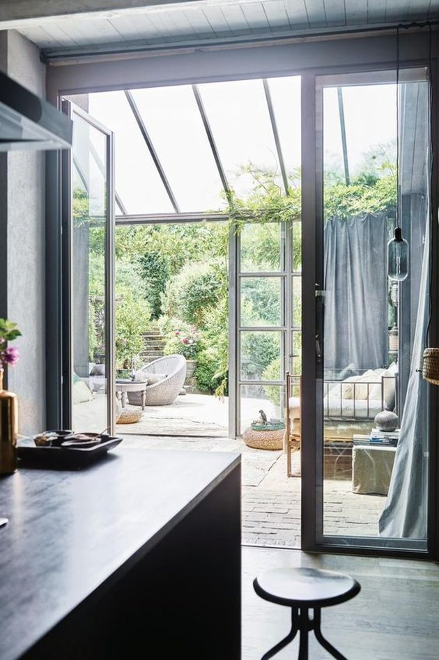 open kitchen leading to solarium style sunroom