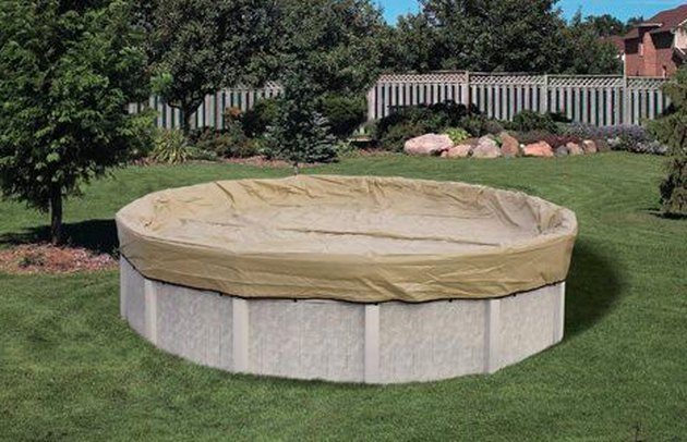 A standard debris cover for an above-ground swimming pool.