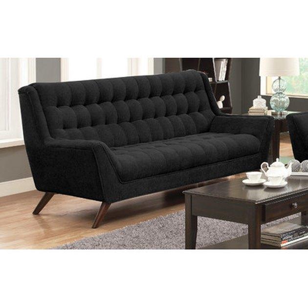 Black tufted sofa