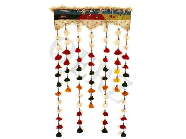 Colorful kilim wall hanging with rainbow tassels