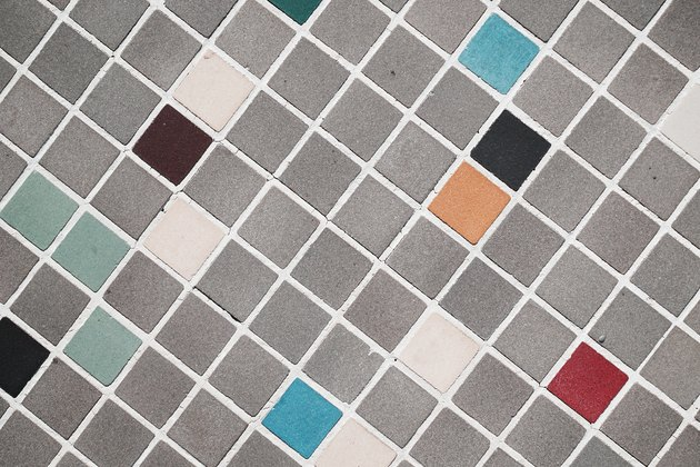 One-inch bathroom tiles cleanly grouted.