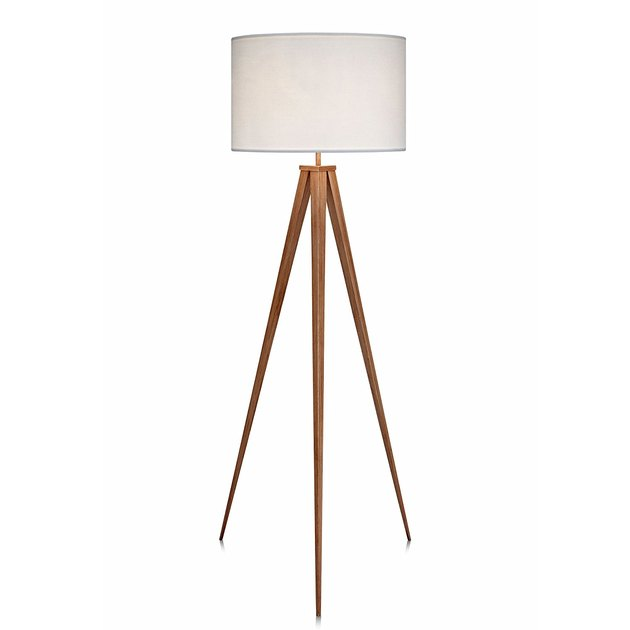 Midcentury floor lamp with white shade and wooden tripod legs