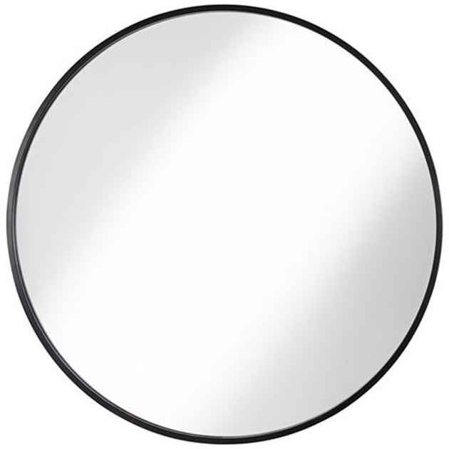 Large circular mirror with black border