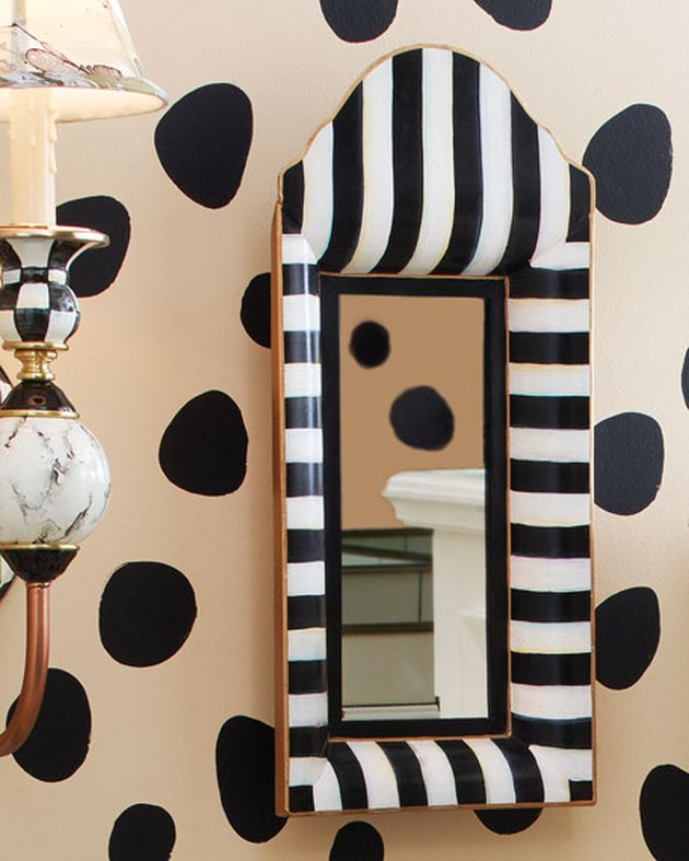 Horchow black-and-white striped mirror.