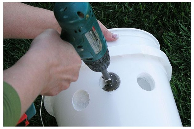 Drill holes in the styrofoam bucket.