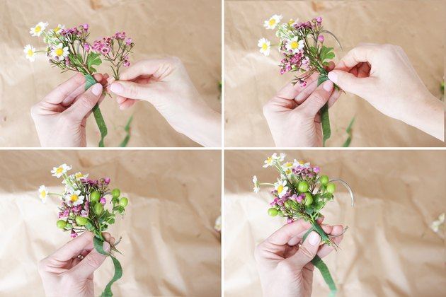 Attaching wax flower and hypericum berries with floral tape