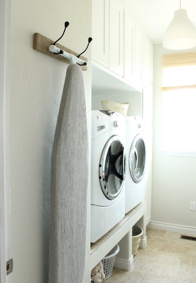wall-mounted ironing board rack