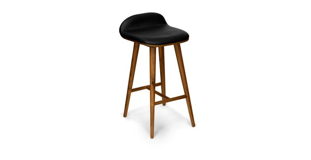 Black backless barstool with wooden legs