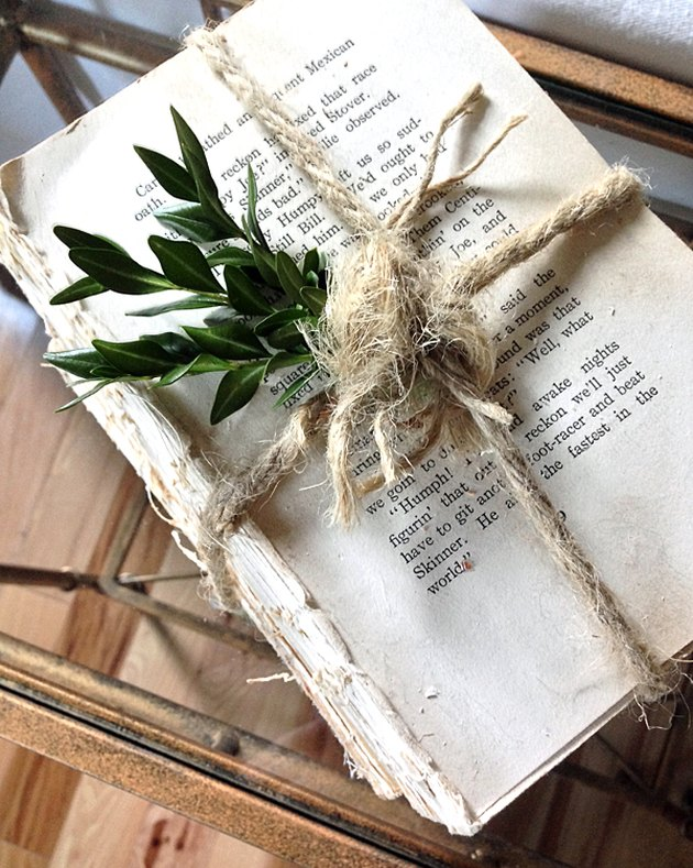 book without cover tied with twine
