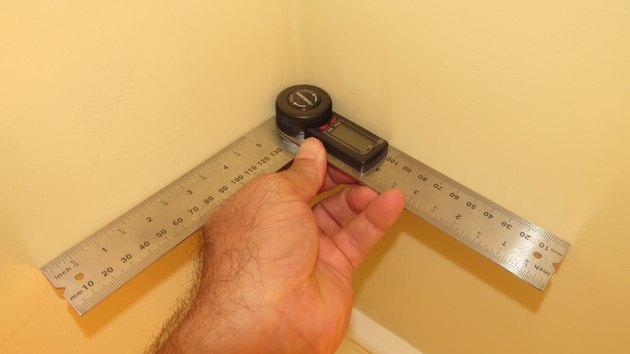 A digital protractor being used on an inside corner.