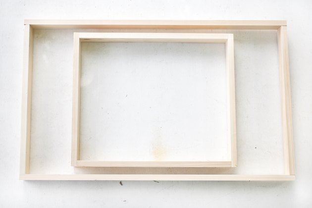 two wooden frames, one small and one large.