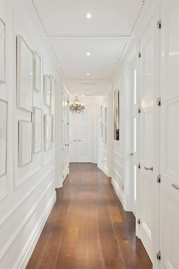 White hallway with molding