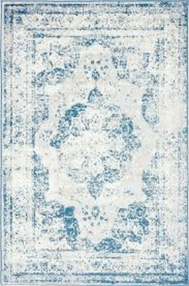 Light blue variegated area rug