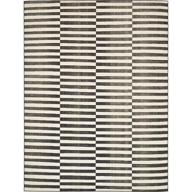 Black and white striped area rug featuring varied columns