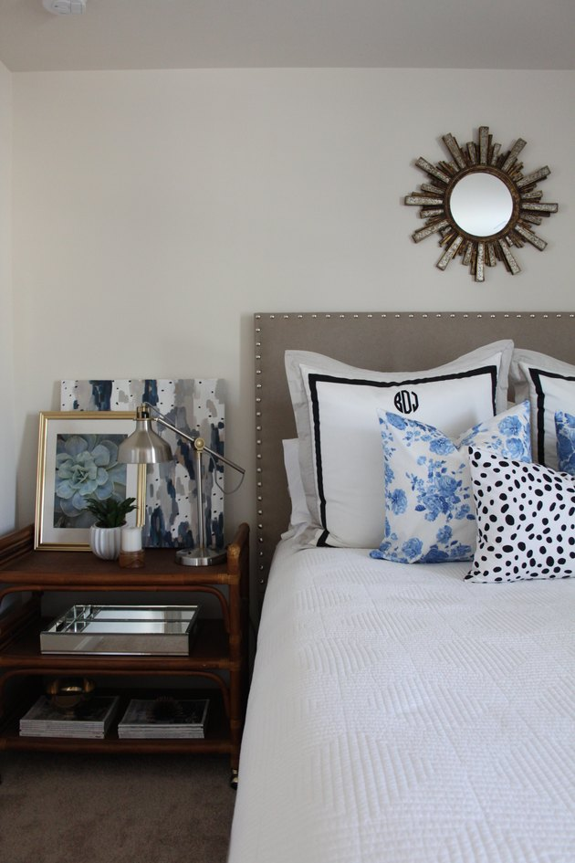DIY upholstered headboard with nailhead trim.