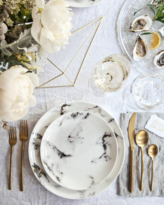 modern tablescape with gold flatware