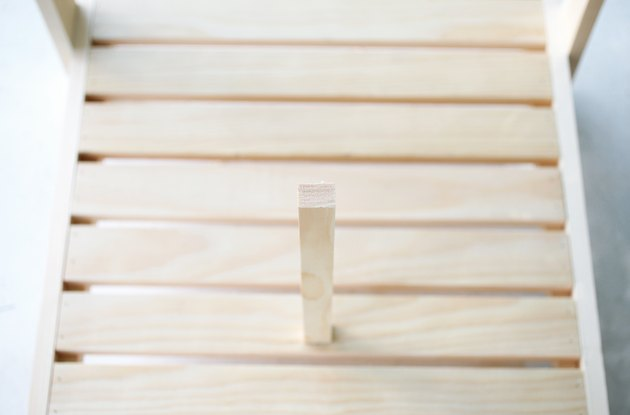 piece of wood nailed into wooden slats.