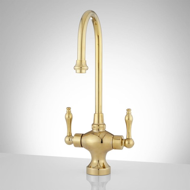 Arched gold faucet