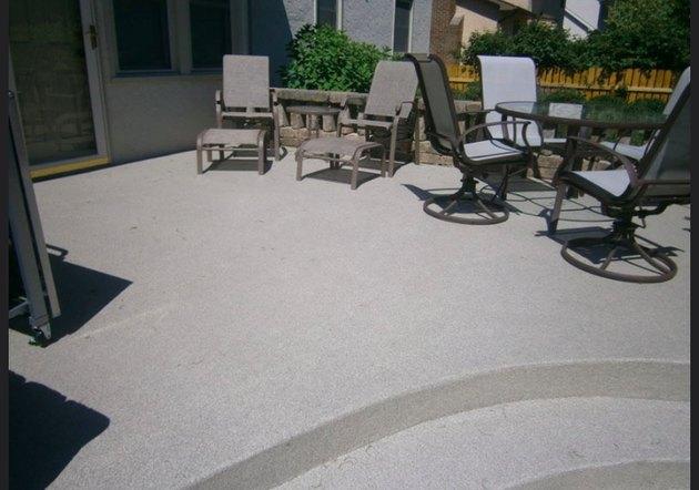 A concrete pool patio.