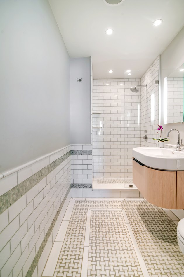 Photo of bathroom with small walk-in shower.