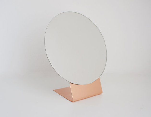 Calvill brass table mirror.