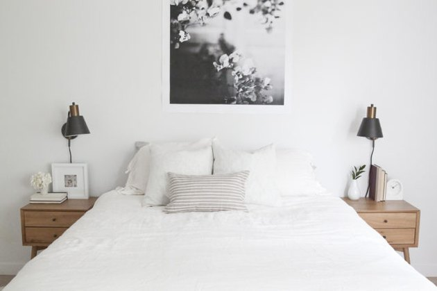 White midcentury bedroom with matching side tables and black lamps