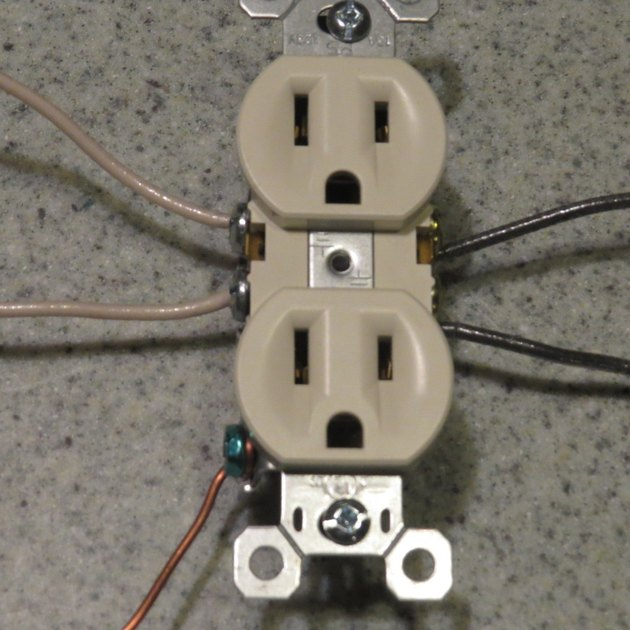 Receptacle with two sets of wires attached.
