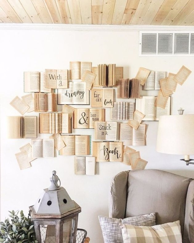 Books with words on them taped to the wall.