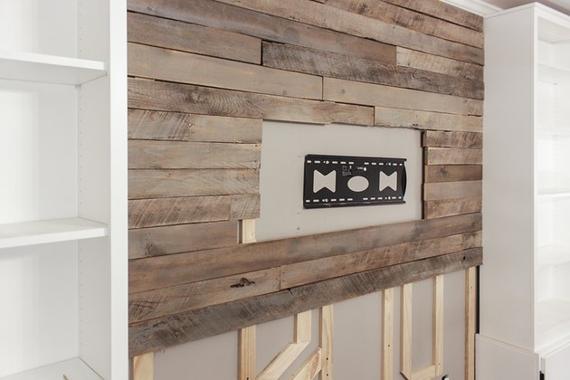 Half-way completed pallet accent wall