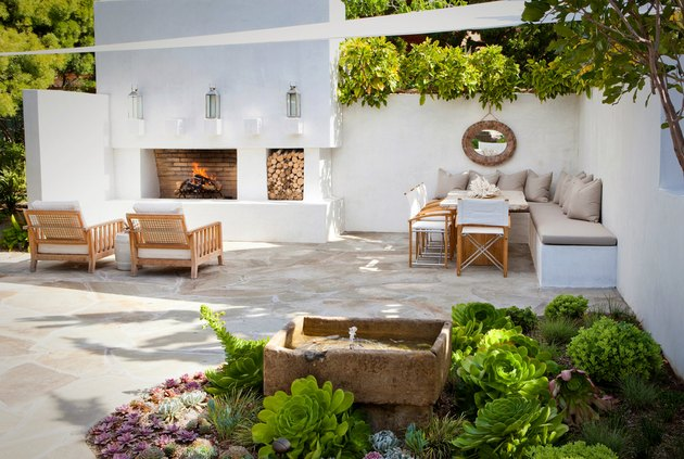 garden with neutral modern decor and white sail shade