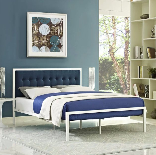blue headboard bed