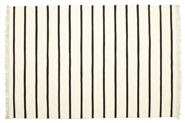 White rug with black stripes